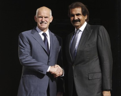 Greece's PM George Papandreou welcomes Qatar's Emir Sheikh Hamad bin Khalifa Al-Thani in Athens