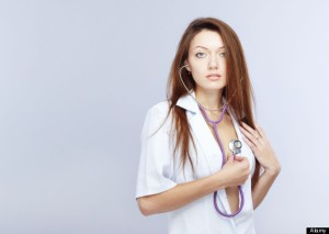 Sexy lady in open medical overall monitoring beat of her heart