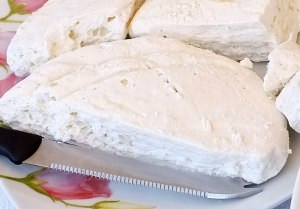 Hard white goat cheese from the village of Kokkinomilia