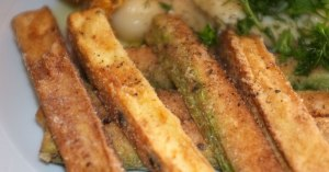 Bacalao confit with zucchini sticks and garlic cloves - detail
