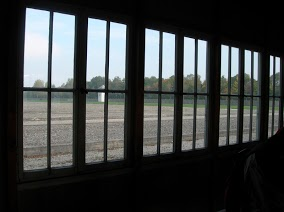 Dachau Concentration Camp - A view from inside of the barracks to the outside