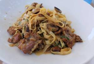 Rabbit with lardon, and mushrooms, served with tagliatelle