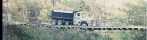 dump truck crossing bridge