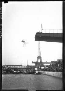 Entertainment-Photo-Person-jumping-off-bridge-on-bike-into-Seine