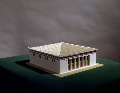 The Old Bouleuterion, about SOO B.C. Model by Fetros Demetriades and Kostas Papoulias. Athens, Agora Museum. Excavations have revealed the foundations of a nearly square building (23.30 m. X 23.80 m.), with a cross wall dividing the structure into a main chamber and entrance vestibule. The main room probably had five supports, although the foundations for only three have been found. There is no trace of seats, but they might be restored as rectilinear tiers of wooden benches on three sides.