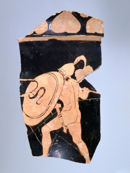 Fragment of an Athenian (Attic) red-figure bell-krater (mixing bowl), Stb century B.C. H.: 0.12 7 m. Athens, Agora Museum P 15837. A warrior with helmet, sword in scabbard, spear and shield (device: snake) attacks an opponent to the left (now missing). (9)