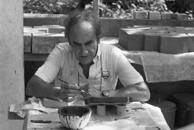 Eduardo Chillida working on the terrace of Mas Bernhard painting his fired sculptures. St Paul de Vence 1973.