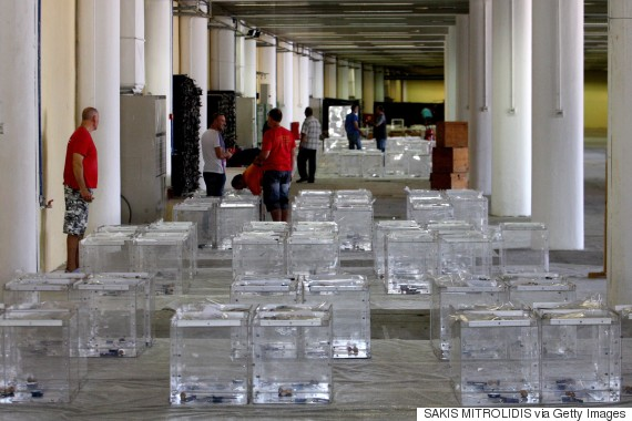 Electoral workers prepare ballot boxes in a warehouse in Thessaloniki on July 2, 2015, ahead of a controversial bailout referendum. Greece's radical left government suggested it would resign if it fails to get its way in a make-or-break referendum July 5 that could decide the country's financial future.   AFP PHOTO / SAKIS MITROLIDIS        (Photo credit should read SAKIS MITROLIDIS/AFP/Getty Images)